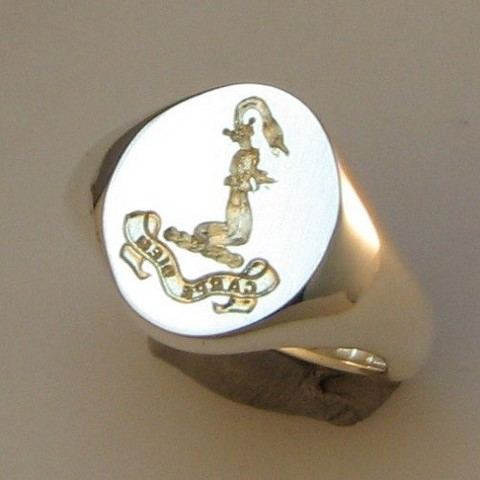 deep reverse crest engraving on silver signet ring