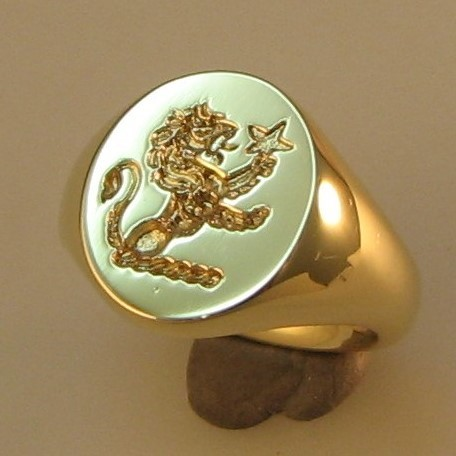 demi lion with star crest engraved signet ring