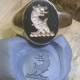 blue tack impression from laser crest engraved signet ring