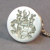 coat of arms dress stud close up